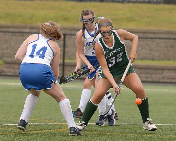 CARL RUSSO/staff photo. NEWBURYPORT NEWS: Pentucket's Talia Beech fights for the ball against Methuen players in field hockey action.  9/10/2018