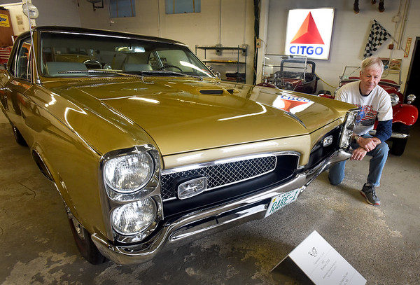 BRYAN EATON/Staff photo. This Oldsmobile GTO is one of several automobiles Jeff Sicard has restored.