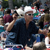 JIM VAIKNORAS/Staff photo A man in a hat holds another hat as he dances at the 92.5 Riverfront Festival in Market Landing Park in Newburyport Saturday.