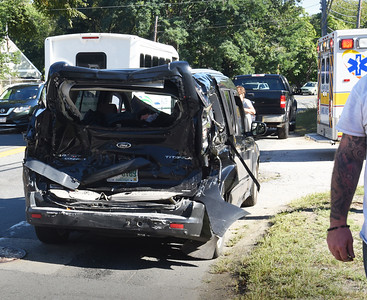 BRYAN EATON/Staff photo. The vehicle involved in the school bus crash was towed from the scene.