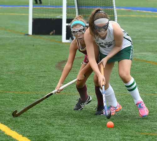 JIM VAIKNORAS/Staff photo Pentucket's Janet Dickson fights for teh ball with Newburyport's Maddie Medeiros during their game at Amesbury Sports park Wednesday.