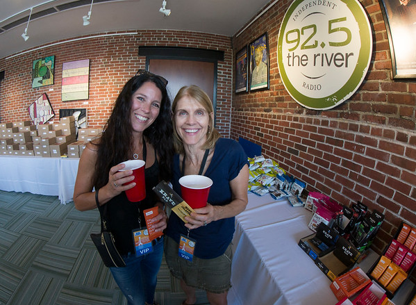 JIM VAIKNORAS/Staff photo Caren Dirksmeir and Laura Rothstein, both from Durham enjoy a beverage at the Firehouse at the 92.5 Riverfront Festival in Newburyport Saturday.