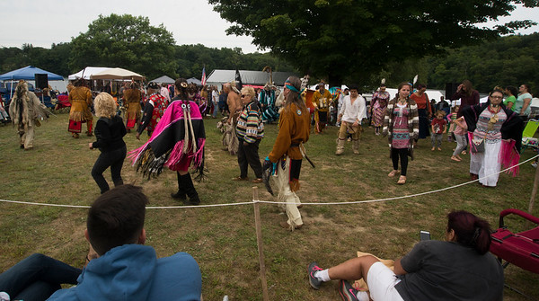 JIM VAIKNORAS/Staff photo Dancers perform an inter-tribal dance during the annual Inter-Tribal Pow Wow at Plug Pond in Haverhill Saturday.