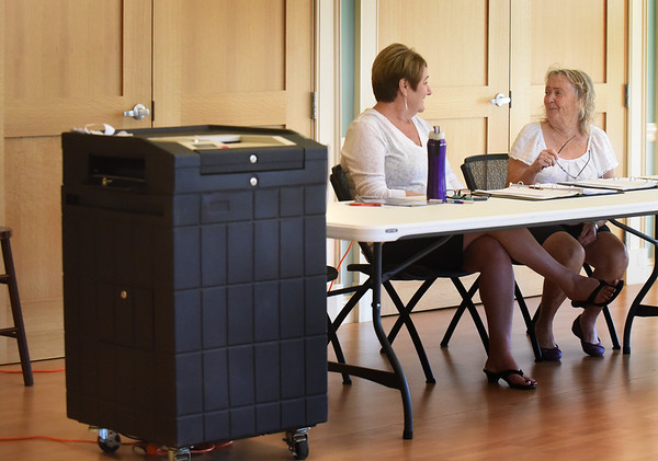 BRYAN EATON/Staff photo. Newburyport election workers Marcia Roaf Frost, left, and Nancy Harrington chat while waiting for voters at precint five at the Newburyport Senior Center.
