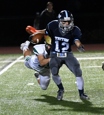 JIM VAIKNORAS/Staff photo Triton's Jack Tummino returns a kick during the Vikings game against North Reading at Triton High School Friday night.