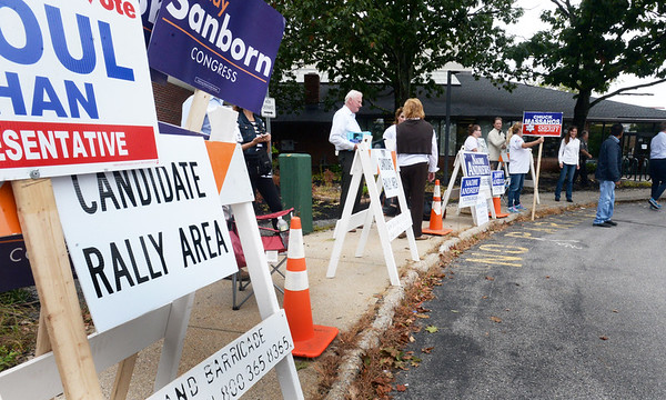 BRYAN EATON/Staff photo. Candidate supporters in Seabrook line up at the Rec Center as New Hampshire voters held their primary on Tuesday.