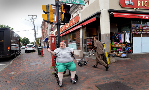 BRYAN EATON/Staff photo. A fixture at the corner of State and Pleasant Streets in Newburyport, Peter Pollard, who some call the Mayor of State Street, is back greeting friends and acquaintances after suffering a bad fall.