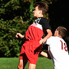 BRYAN EATON/Staff photo. Richard Morris heads the ball as Newburyport's Max Gagnon covers.