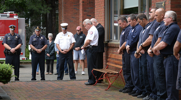 BRYAN EATON/Staff photo. Newburyport Fire Chief Christopher LeClaire leads a moment of silence at a remembrance of those killed in the 9/11 attacks.