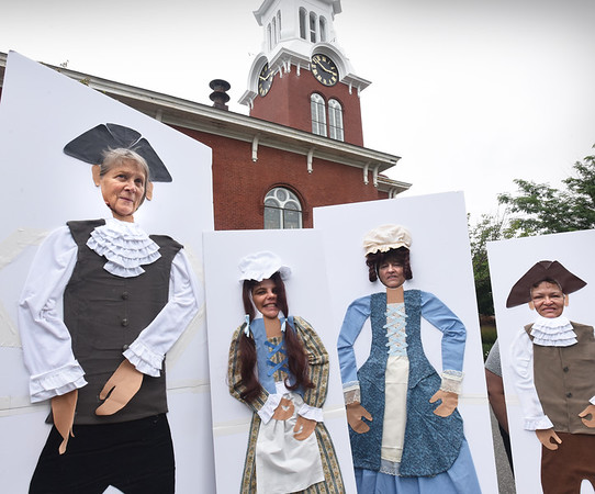 BRYAN EATON/Staff photo. Member of the Central Congregational Church in Newburyport pose in cut-out which people can have their picture taken in on Saturday. The church is celebrating its 250th anniversary in Brown Park this Saturday from 3-7:00 p.m. Posing, from left, Amantha Moore, Jill  St. Onge, who created the artwork, Hilary Hawkins and Elaine Goodwin.