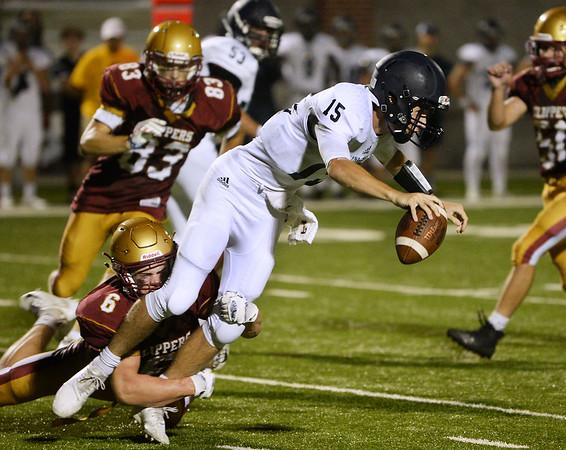 CARL RUSSO/staff photo. NEWBURYPORT NEWS: Newburyport's Seamus Webster tackles Lynnfield's quarterback, Brett Cohee for the sack in football action. 9/7/2018