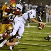 CARL RUSSO/staff photo. NEWBURYPORT NEWS: Newburyport's Seamus Webster tackles Lynnfield's quarterback, Brett Cohee for the sack in football action. 9/7/2018