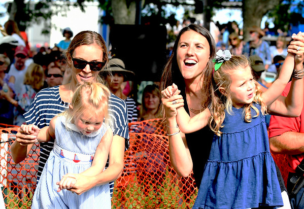 """JIM VAIKNORAS/Staff photo Jess Runnals, with her daughter Nora, 4, and Annelle Stuppy with her daughter Evie, 4, dance to the music of Philip Phillips the 92.5 Riverfront Festival in Market Landing Park in Newburyport Saturday. Evie was born to Phillips song """"Home""""."""