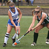CARL RUSSO/staff photo. NEWBURYPORT NEWS: Pentucket's Clara Dore, right fights for the ball with Methuen captain, Liz Zins in field hockey action.  9/10/2018