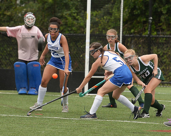 CARL RUSSO/staff photo. NEWBURYPORT NEWS: Pentucket's Meagan Bean, right fights to clear the ball in front of her net against Methuen's Selena Fadika and Claudia Crowe, 5 in field hockey action.  9/10/2018
