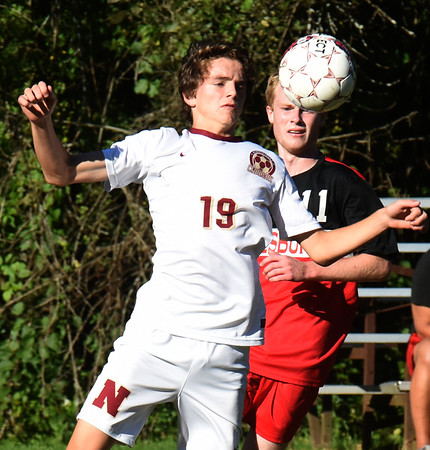 BRYAN EATON/Staff photo. Newburyport's Brady O'Donnell and Sean Reagan have their eyes on the ball.
