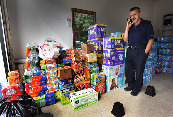 BRYAN EATON/Staff photo. Groveland resident Joe D'Amore of Merrimack Valley Hope Mission is one of several groups collecting food pantry-type items to assist victims of the gas explosions and fires in Lawrence, Andover and North Andover. The supplies, which are being kept in his garage a 9 Cherry Tree Lane, will be picked up Saturday morning at 8:00 a.m. for delivery.