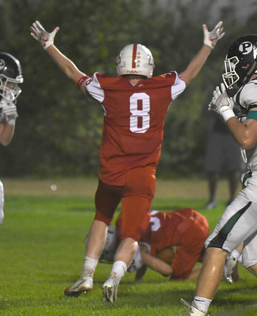 JIM VAIKNORAS/Staff photo Amesbury's Austin Hallisey celebratea first quarter touchdown against Pentucket at Landry Stadium in Amesbury Friday.