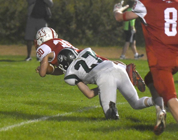 JIM VAIKNORAS/Staff photo Amesbury's Hayden Ayotte drags  Pentucket's Andrew Melone across the goalline at Landry Stadium in Amesbury Friday.