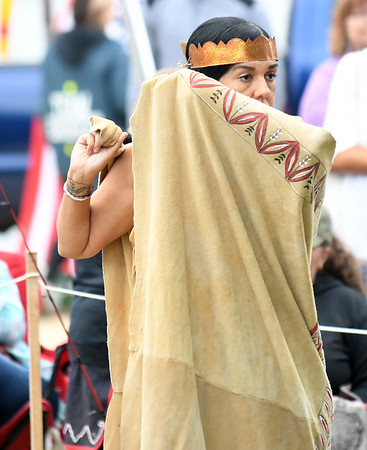 JIM VAIKNORAS/Staff photo Kerri Helme of the Wampanoag performs a Blanket Dance at the annual Inter-Tribal Pow Wow at Plug Pond in Haverhill Saturday.