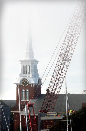 BRYAN EATON/Staff photo. The steeple of the Central Congregational Church in Newburyport fades into a recent misty sky in a view from the Gillis Bridge.