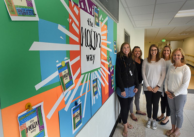 BRYAN EATON/Staff photo. Several of the PBIS team gather at the Molin Way poster, from left, Jesssica Burke; Tara Rossi, principal; Stefanie Berger; Kristin Smolski and Alissa  Gallegos.
