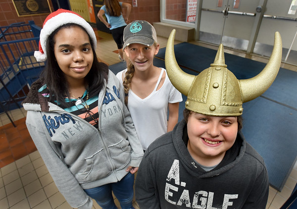 BRYAN EATON/Staff photo. Triton Middle School students are having various fundraisers to help victims of the gas explosions in Greater Lawrence last week. Wednesday was Hat Day where students could wear a hat for a one dollar donation, from left, Shanell Parra, 13, Emma Morland, 13, and Dean Gioia, 12.