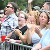 JIM VAIKNORAS/Staff photo Fans cheer the Barenaked Ladies the 92.5 Riverfront Festival in Market Landing Park in Newburyport Saturday.