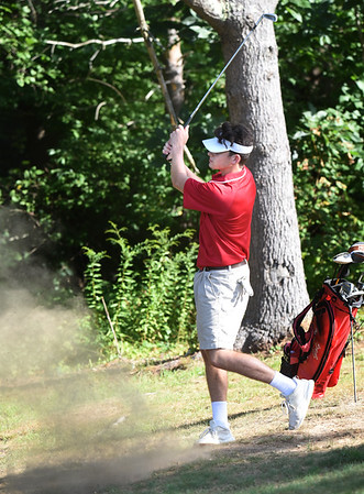 BRYAN EATON/Staff photo. Will Connolly hits on  the first hole.