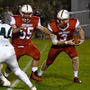 JIM VAIKNORAS/Staff photo Amesbury's gets a block from John Nelson against Pentucket at Landry Stadium in Amesbury Friday.