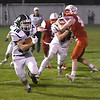 JIM VAIKNORAS/Staff photo  Pentucket Keegan O'Keefe breaks a run against Amesbury at Landry Stadium in Amesbury Friday.