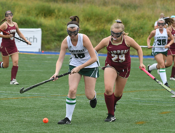 JIM VAIKNORAS/Staff photo Pentucket's Jacqui Cloutier is covered by  Newburyport's Alysese Ferreira during their game at Amesbury Sports park Wednesday.