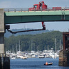 BRYAN EATON/Staff photo. A boater heads under the Gillis Bridge which connects Newburyport and Salisbury as crews have been inspecting and making repairs to Tuesday and Wednesday. The bridge opened in 1972 replacing a span bridge that was built in 1902.