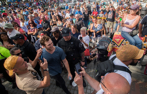 JIM VAIKNORAS/Staff photo  Phillip Phillips is surrounded by fans as he leaves the stage at the 92.5 Riverfront Festival in Market Landing Park in Newburyport Saturday.