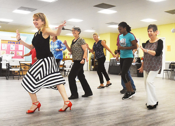 BRYAN EATON/Staff photo. Billed as Ballroom Dancing lessons, in fact teacher Ivana Ruzkova, left, teaches various types of dance at the Hilton Senior Center in Salisbury. The class meets every Wednesday at 10:00am and they are hoping for more people to join.