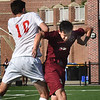 BRYAN EATON/Staff photo. Masconomet's #10 and Newburyport's Ryan Archer collide.