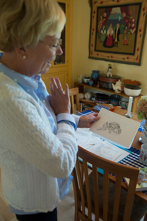 "JIM VAIKNORAS/Staff photo Donna Seim talks about a Drawing by Susan Spellman for the book ""Cheeky and Charlemagne""."