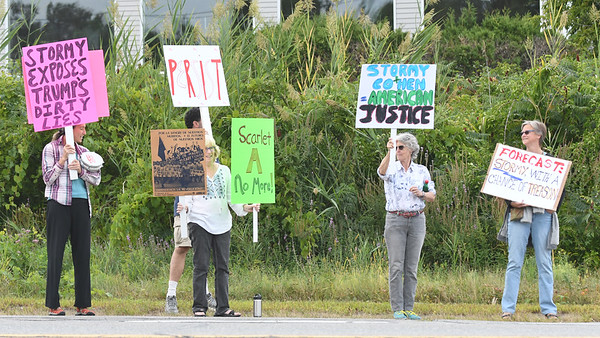 JIM VAIKNORAS/Staff photo About a half dozen people hold signs in support of porn star Stormy Daniels across the street from Kittens Gentlemen's Club on Bridge Road in Salisbury Friday night where the actress is performing this weekend.