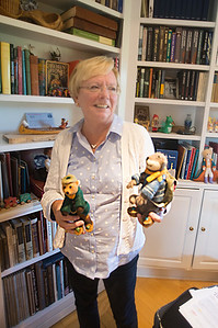 """JIM VAIKNORAS/Staff photo Donna Seim hold Cheeky and Charlemagne, felt doll she made for her book  """"Cheeky and Charlemagne""""."""