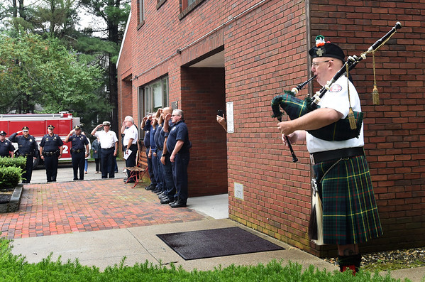 "BRYAN EATON/Staff photo. Retired Newburyport firefighter Jim MacDonald, who went to New York City when 9/11 occured and stayed 14 days assisting other first responders, plays ""Amazing Grace."""