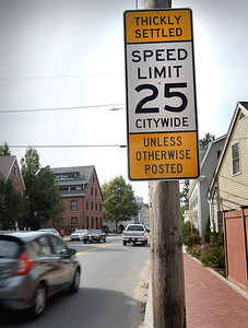 BRYAN EATON/Staff photo. This sign on Merrimac Street is one of several in Newburyport reminding motorists of the city's recent adoption of the speed limit rule.