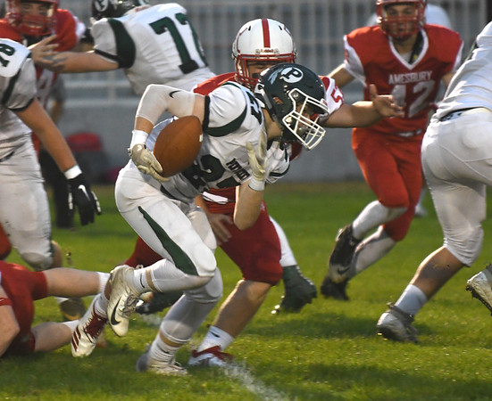 JIM VAIKNORAS/Staff photo  Pentucket's  Andrew Melone breaks a tackle against Amesbury at Landry Stadium in Amesbury Friday.