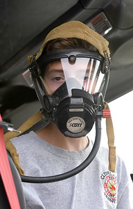 JIM VAIKNORAS/Staff photo Chris Nadeau, 14, of West Newbury tries a respirator face mask at an open house at the Groveland fire station Saturday. Chris is a member of the Junior Firefighter program in Groveland.
