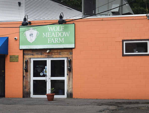 BRYAN EATON/Staff photo. Cheesemakers at Wolf Meadow Farm on High Street in Amesbury.