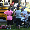 BRYAN EATON/Staff photo. Medical crews attend to one of three students from Salisbury Elementary School who appeared to have minor injuries as their bus apparently went into the back of an SUV. The accident happend on Lafayette Road (Route One) at the intersection of Gerrish Road at about 3:15pm on Friday.