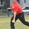 JIM VAIKNORAS/Staff photo  Mike Sweeney pitches for the Amesbury Fire Dept. against the Amesbury Police Saturday at the Amesbury 250th Town Picnic at Amesbury Town Park.