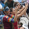 JIM VAIKNORAS/Staff photo THree women in native dress record on of the dances during the annual Inter-Tribal Pow Wow at Plug Pond in Haverhill Saturday.