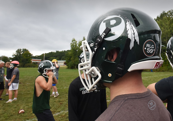 BRYAN EATON/Staff photo. Reid Garrant died suddenly of leukemia earlier this year. This fall he is being honored by the Pentucket football program, which will wear helmet decals and jersey patches of his old No. 59 in his memory.