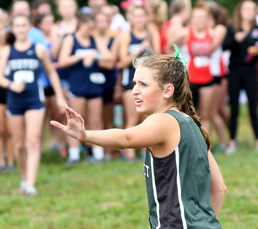JIM VAIKNORAS/Staff photo Pentucket's Jess Galvin wiat for the baton at the Clipper Relay at Maudslay State Park Saturday.