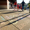 "BRYAN EATON/Staff photo. Students heading into Salisbury Elementary School on Tuesday morning were greeted with signs written in chalk, here, ""Welcome Back"" and other words of encouragement. The messages were written by members of the school's PTA."